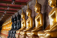 Buddha statues and sacral decorations in Royal Palace, Thailand. Stock Images