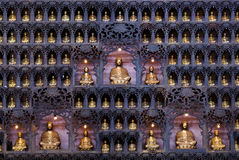 Buddha Statues. Several golden Buddha statues displayed in a temple, creating solemn and peaceful atmosphere royalty free stock image