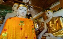 Buddha statues in Shwedagon Pagoda, Yangon Stock Photo