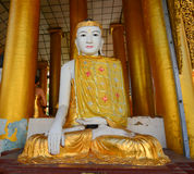 Buddha statues in Shwedagon Pagoda, Yangon. Buddha statue in Burma famous sacred place and tourist attraction landmark - Shwedagon Paya pagoda, Yangon, Myanmar Stock Photography