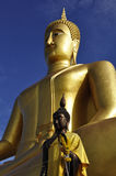 Buddha statues soaring in blue sky Stock Images
