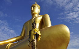 Buddha statues soaring in blue sky stock image