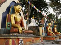 Buddha statues. Statues of Buddha at Swayambhunath stupa monkey Temple in Kathmandu, Nepal Stock Photography