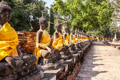 Buddha statues at the temple in Thailand. Row of Buddha statues at the temple of Wat Yai Chai Mongkol in Ayutthaya, Thailand Royalty Free Stock Photo