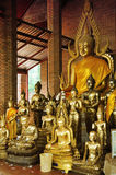 Buddha statues in a temple Stock Photos
