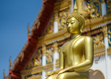 Buddha statues at Thai temples. One of many Buddha statues at a temple in Thailand.There are many of such temples around Thailand all very ornate, bright and Royalty Free Stock Photo