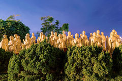Buddha statues with trees Stock Photography