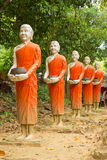 Buddha statues Walking alms round. Buddha statues in the thai temple Stock Photography