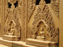 Buddha statues on the wall Stock Photography