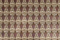 Buddha statues wall pattern Royalty Free Stock Image