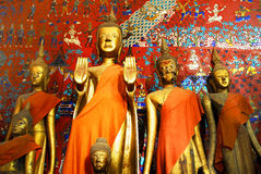 Buddha statues in Wat Xieng Thong Stock Images