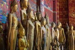 Buddha statues at the Wat Xieng Thong temple in Luang Prabang Royalty Free Stock Photography