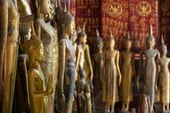 Buddha statues at the Wat Xieng Thong temple in Luang Prabang Stock Photos