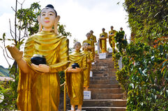 Buddha statues were walking alms. Down from the mountain royalty free stock photography