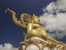 Buddha status with blue sky at Samui Stock Photos
