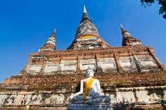Buddha Status and the pagoda at wat yai chaimongkol temple Stock Photo