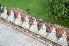 Buddha Status and the pagoda at wat yai chaimongkol temple. Ayutthaya , Thailand stock image