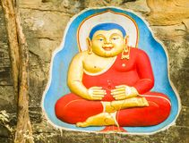 Buddha status on the  rock Royalty Free Stock Image