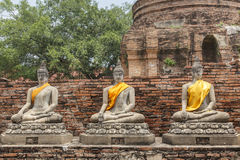 Buddha Statuses at the temple of Wat Yai Chai Mongkol in Ayutthaya near Bangkok, Thailand Stock Photography
