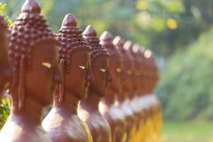 Buddha stellen gegenüber Stockfotografie