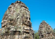 Buddha stellt auf Türmen in Bayon-Tempel in Kambodscha gegenüber Stockfotografie