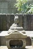 Buddha stone sculpture. A buddha stone sculpture with a snake bo stock images