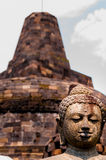 Buddha stone sculpure sitting in front of stupa Royalty Free Stock Photography