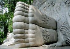 Buddha stone statue feet Royalty Free Stock Photo
