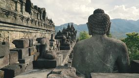 Buddha stone statue on wall of Borobudur temple