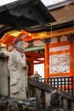 Buddha stone statue wearing a red cap at the Kiyomizu-dera Temple in Kyoto, Japan. Ancient Buddha stone statue wearing a red cap at the famous Kiyomizu-dera royalty free stock photo