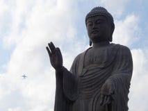 Buddha stops Airplane Stock Photo