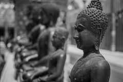 Buddha. Stucco buddha placed obviously fine spot. Black and white photo Royalty Free Stock Images