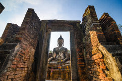 Buddha sukhothai Thailand. Landmark big seated buddha statue in temple ruins of wat si chum sukhothai historical park in northern thailand Stock Photos
