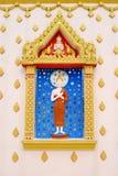 Buddha sulla parete Fotografia Stock