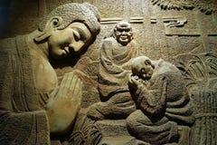 Buddha sulla parete Fotografie Stock Libere da Diritti