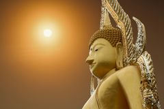 Buddha at sunrise. The Buddha at sunrise has a golden background Royalty Free Stock Photos
