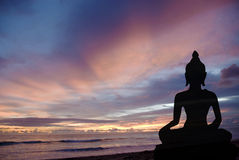 Buddha at sunset. Silhouette of Buddha during sunset at the beach Stock Images