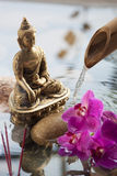 Buddha symbol with incense burning in water Stock Image