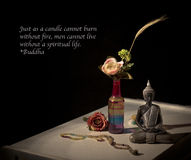 Buddha on table. Buddha, flowers and religion on the table Stock Photos