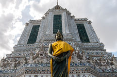 Buddha with temple building background. At Wat Arun Ratchawararam Ratchaworamahawiharn, Bangkok, Thailand royalty free stock images