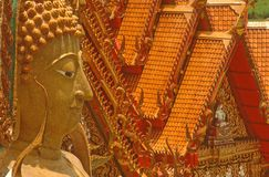 Buddha and temple roofs, Thailand. stock photo