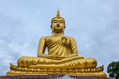 Buddha in temple. Thailand is golden color,blue sky background Royalty Free Stock Photo