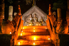 Buddha thai art with oil lamp in temple at night. At chiangrai thailand Royalty Free Stock Image