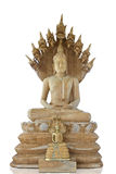 Buddha and Thai naga style. Buddha sculpture and nine headed naga made from wood,Generality in Thailand,any kind of art decorated in Buddhist church,temple hall stock photo
