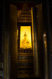 Buddha in thai temple. Dramatic buddha image view from temple gate Stock Photo