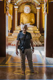 Buddha and tourist inside the Tample Royalty Free Stock Image