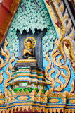 Buddha on triangle of Buddhist temple in Thailand.  Stock Photo
