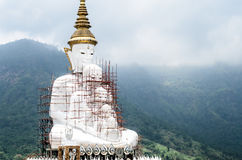 Buddha with under construction at wat pha sorn kaew Royalty Free Stock Photo