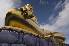 Buddha under the sky. Image of a Buddha under a beautiful blue sky Royalty Free Stock Image