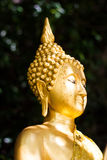 Buddha in valley. Gold color Sculpture Royalty Free Stock Photo